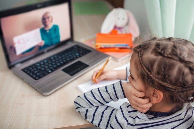 """<span class=""""caption"""">Video calling might help us feel more connected to other during social distancing.</span> <span class=""""attribution""""><a class=""""link rapid-noclick-resp"""" href=""""https://www.shutterstock.com/image-photo/pretty-stylish-schoolgirl-studying-homework-math-1675198060"""" rel=""""nofollow noopener"""" target=""""_blank"""" data-ylk=""""slk:Maria Symchych/ Shutterstock"""">Maria Symchych/ Shutterstock</a></span>"""