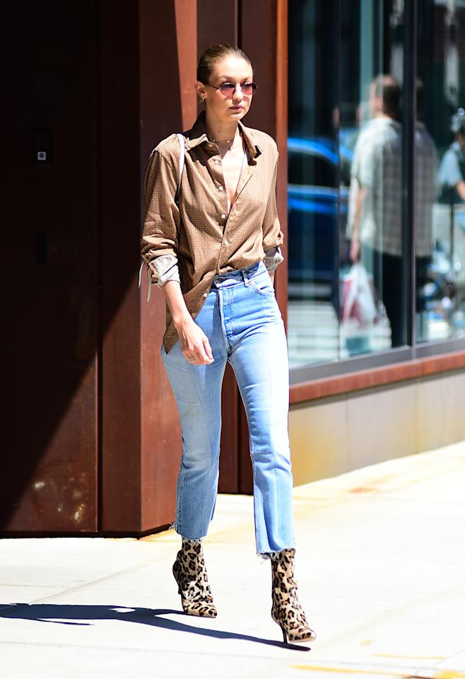 <p>I'm beginning to think that Gigi's closet is literally just a room full of mom jeans – and honestly I'm jealous af. She paired her faves with an androgynous button-up and the most badass booties you've ever seen. </p>
