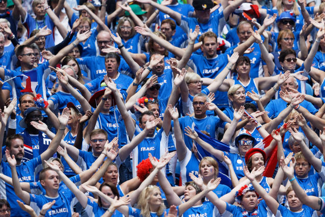French fans cheer for their compatriot Kristina Mladenovic during her match against Australia's Ash Barty in their Fed Cup tennis final in Perth, Australia, Sunday, Nov. 10, 2019. (AP Photo/Trevor Collens)