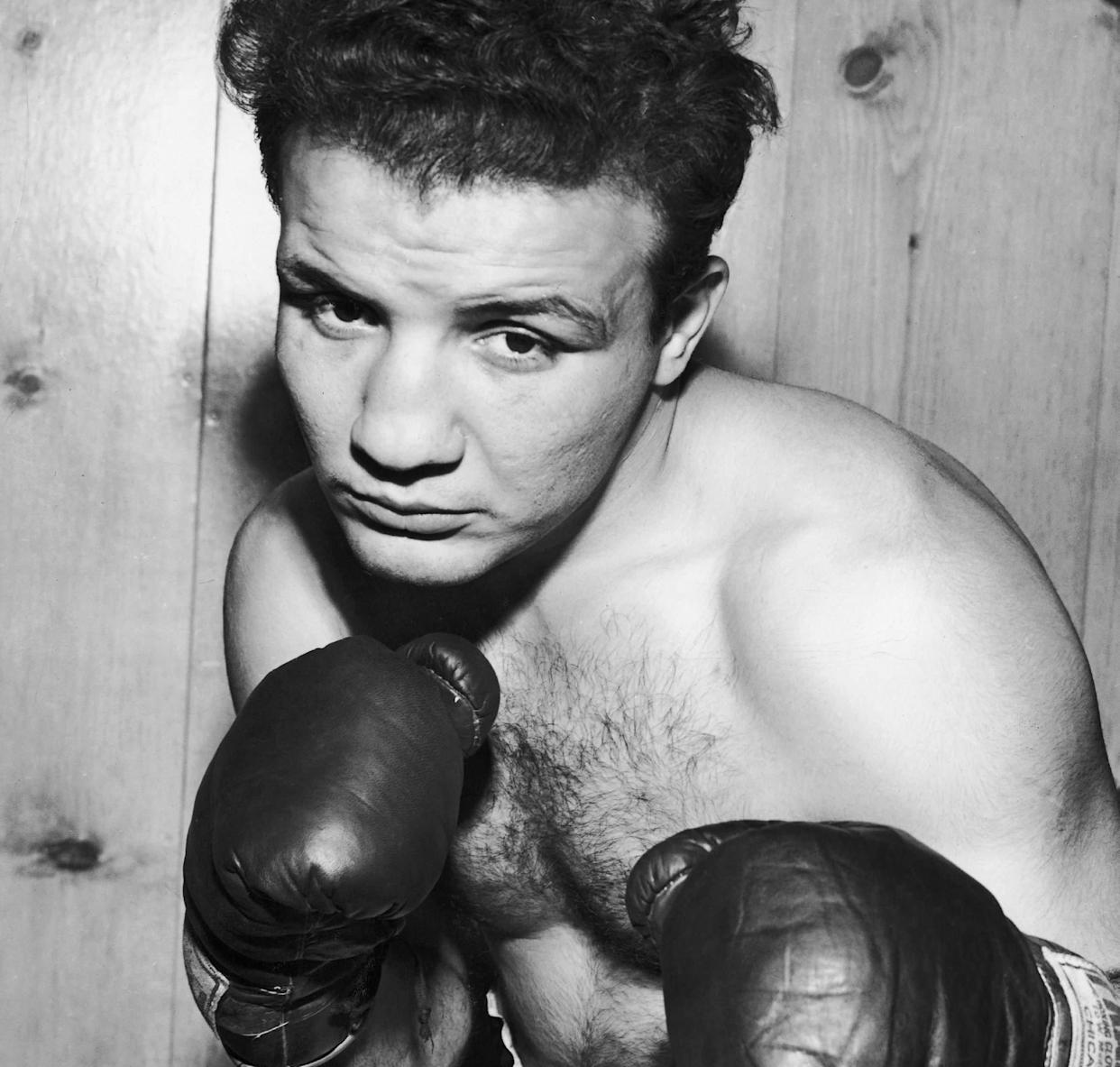 "Jake LaMotta, the boxing legend whose life story became the basis of Martin Scorsese's classic film ""Raging Bull,"" died on Sept. 19, 2017. He was 95."