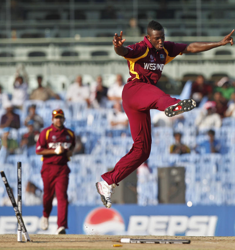West Indies' bowler Andre Russell celebrates on the dismissal of England batsman Ravi Bopara during the Cricket World Cup match between England and West Indies in Chennai, India, Thursday, March 17, 2011. (AP Photo/Gurinder Osan)