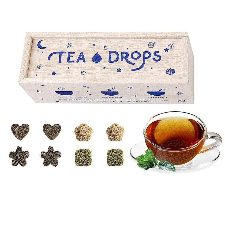 "<p><strong>Tea Drops</strong></p><p>amazon.com</p><p><strong>$16.99</strong></p><p><a href=""https://www.amazon.com/dp/B0155KFTHS?tag=syn-yahoo-20&ascsubtag=%5Bartid%7C10055.g.225%5Bsrc%7Cyahoo-us"" rel=""nofollow noopener"" target=""_blank"" data-ylk=""slk:Shop Now"" class=""link rapid-noclick-resp"">Shop Now</a></p><p>Better than your basic tea bags, these flower, heart, or square-shaped loose leaf teas can be dropped straight in a mug of hot water without an infuser or strainer.</p>"