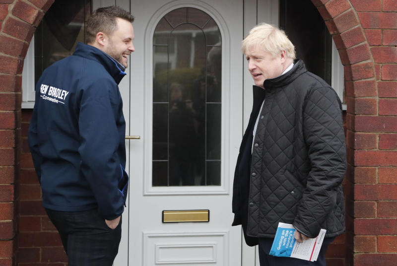 MANSFIELD, UNITED KINGDOM - NOVEMBER 16: Britain's Prime Minister Boris Johnson (R) accompanies Conservative party candidate for the Mansfield constituency Ben Bradley (L) canvasing during a General Election campaign trail stop on November 16, 2019 in Mansfield, England. (Photo by Frank Augstein-WPA Pool/Getty Images)