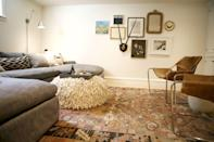 """<p>Bring modern boho style to your basement with a vintage (or vintage-inspired) rug and a textured ottoman. This look feels lived-in—in the best possible way! </p><p><strong>See more at <a href=""""https://www.katiehackworth.com/blog/domaine-feature-basement-reveal"""" rel=""""nofollow noopener"""" target=""""_blank"""" data-ylk=""""slk:Katie Hackworth"""" class=""""link rapid-noclick-resp"""">Katie Hackworth</a>. </strong></p><p><a class=""""link rapid-noclick-resp"""" href=""""https://go.redirectingat.com?id=74968X1596630&url=https%3A%2F%2Fwww.walmart.com%2Fip%2FWell-Woven-Talya-Heriz-Oriental-Medallion-Vintage-Red-Area-Rug-3x5-3-11-x-5-3%2F341856219&sref=https%3A%2F%2Fwww.thepioneerwoman.com%2Fhome-lifestyle%2Fdecorating-ideas%2Fg34763691%2Fbasement-ideas%2F"""" rel=""""nofollow noopener"""" target=""""_blank"""" data-ylk=""""slk:SHOP RUGS"""">SHOP RUGS</a></p>"""