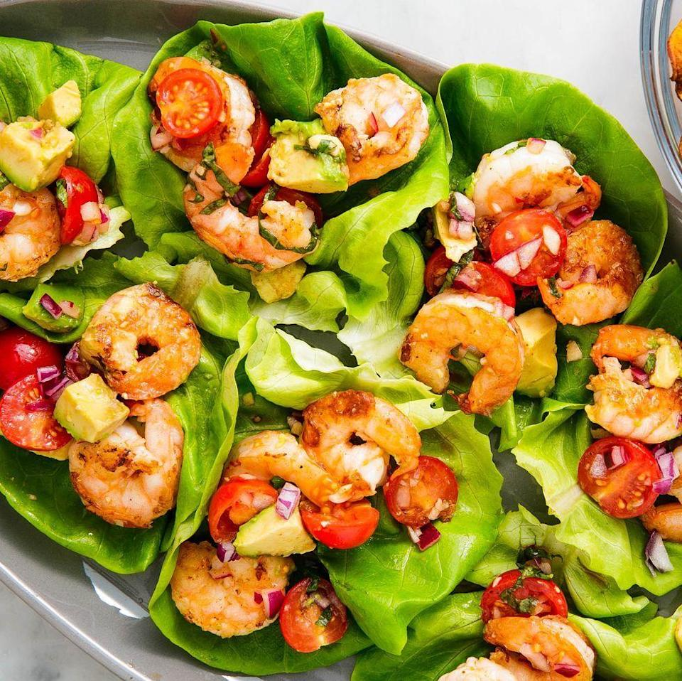 "<p>Lettuce wraps are the one of the best ways to eat healthy (and low carb). These wraps are stuffed with our new favourite twist on prawn salad: basil avocado.</p><p>Get the <a href=""https://www.delish.com/uk/cooking/recipes/a34959586/avocado-shrimp-salad-lettuce-wraps-recipe/"" rel=""nofollow noopener"" target=""_blank"" data-ylk=""slk:Basil Avocado Prawn Salad Wraps"" class=""link rapid-noclick-resp"">Basil Avocado Prawn Salad Wraps</a> recipe.</p>"