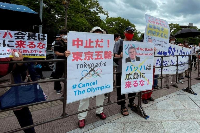 Protesters held banners and placards as International Olympic Committee president Thomas Bach visited the Hiroshima Memorial Cenotaph on Friday
