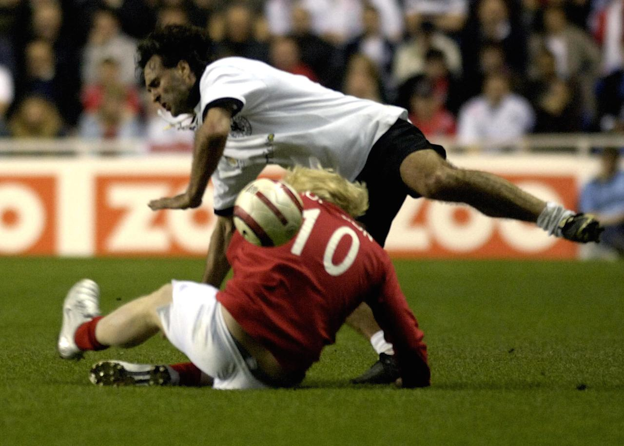 England's Boris Johnson tackles Germany's Maurizio Gaudino during the Legends match at the Madejski Stadium in Reading (Picture: PA)