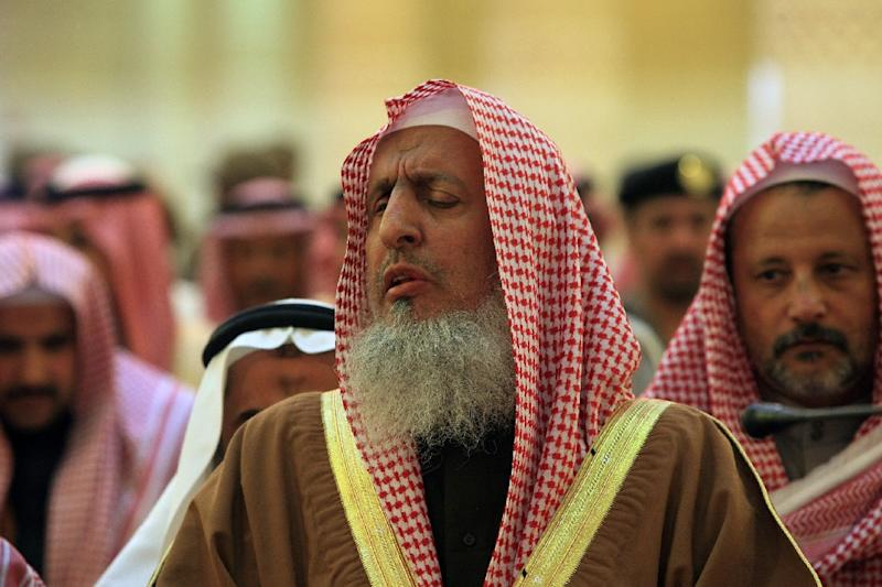 Saudi's Grand Mufti Sheikh Abdul Aziz al-Sheikh (C) has absolved Saudi authorities of blame for the hajj stampede