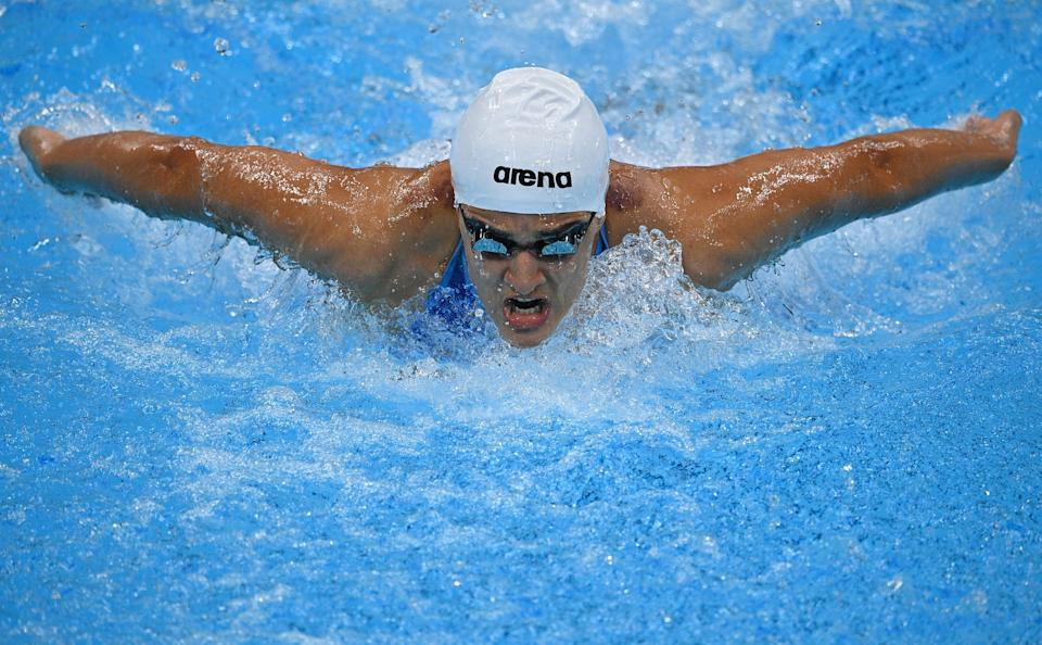 Azerbaijan's Mariam Sheikhalizadehkhanghah competes in a heat for the women's 100m butterfly swimming event during the Tokyo 2020 Olympic Games at the Tokyo Aquatics Centre in Tokyo on July 24, 2021. (Photo by Oli SCARFF / AFP) (Photo by OLI SCARFF/AFP via Getty Images)