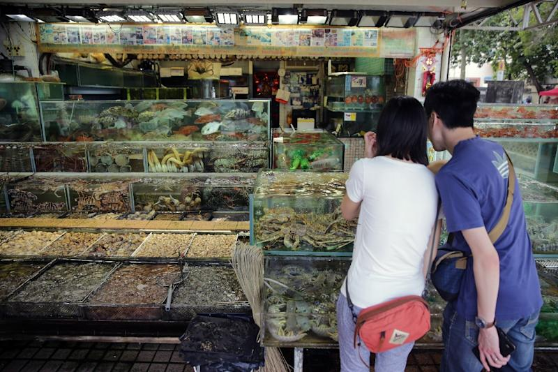 Seafood is ubiquitous in Hong Kong, where customers often choose their fish live from a tank (AFP Photo/Isaac Lawrence)