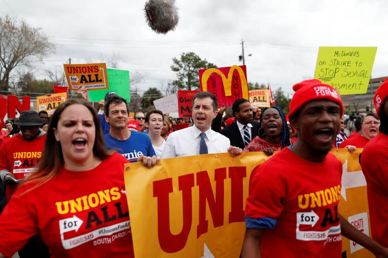 Democratic U.S. presidential candidate and former South Bend Mayor Pete Buttigieg marches with striking McDonald's workers while campaigning in Charleston