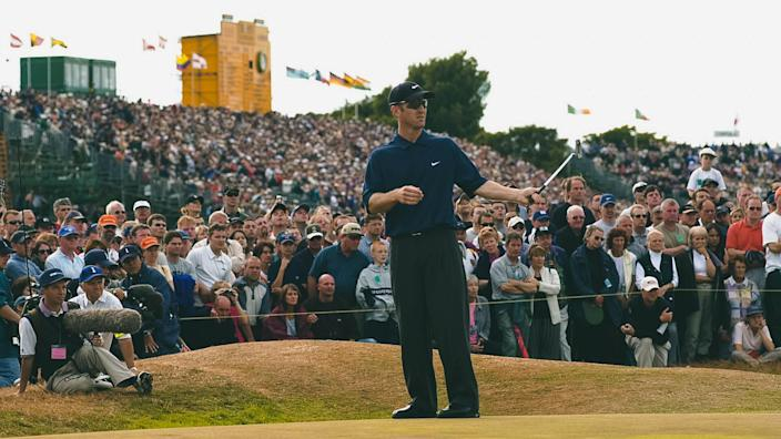 BRITISH OPEN GOLF CHAMPIONSHIP JULY 2001 LYTHAM DAVID DUVAL PUTTS ON THE 17TH GREEN ON HIS WAY TO WINNING THE TOURNAMENT SURROUNDED BY FANSBRITISH OPEN GOLF CHAMPIONSHIP JULY 2001 LYTHAM DAVID DUVAL PUTTS ON THE 17TH GREEN ON HIS WAY TO WINNING THE TOURNAMENT SURROUNDED BY FANS.