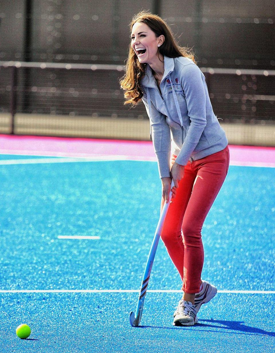 <p>The Duchess is always happy playing field hockey. She practiced with the Women's GB Hockey team at the Olympic Park while wearing a zip-up sweatshirt, bright jeans, and comfy sneakers. </p>