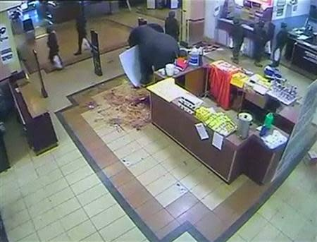 A CCTV video still shows what appears to be soldiers carrying plastic shopping bags as they leave the Nakumatt supermarket in the Westgate shopping mall in Nairobi