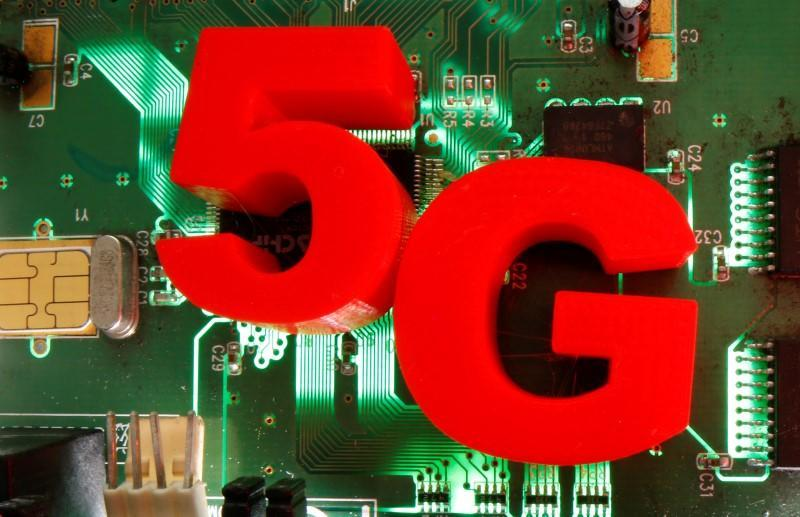 3d printed objects representing 5G are put on a motherboard in this picture illustration