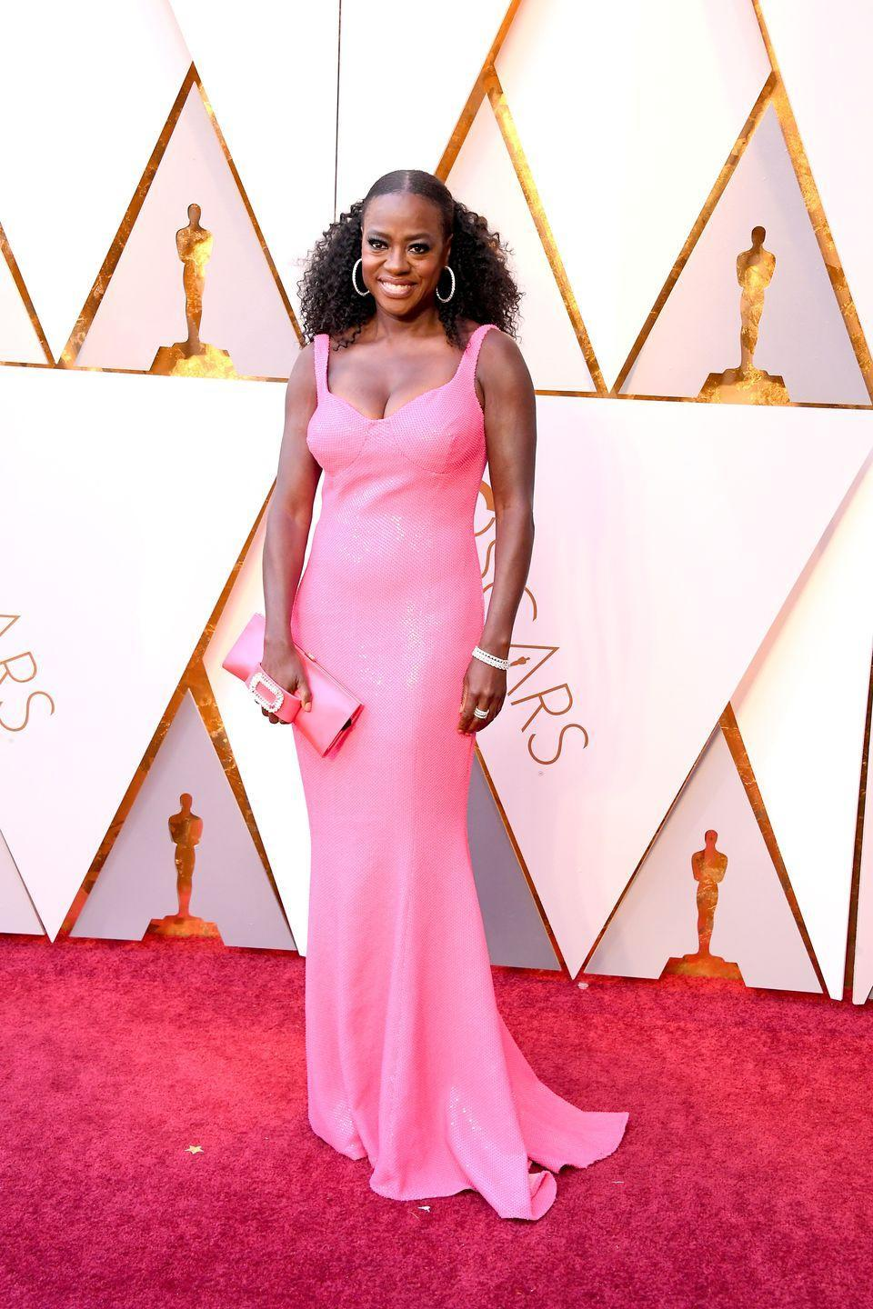 <p>Viola donned a bright pink sequin Michael Kors gown and accessorized with a matching clutch and sparkly hoop earrings in 2018. She won the Best Supporting Actress Oscar the previous year for her emotional performance in <em>Fences</em>, and presented the award for Best Supporting Actor to Sam Rockwell this year. </p>