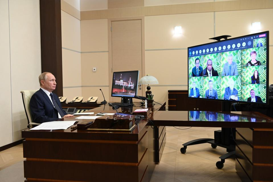 Russian President Vladimir Putin delivers a video statement to participants of special meeting of APEC leaders at the Novo-Ogaryovo residence outside Moscow, Russia, Friday, July 16, 2021. (Alexei Nikolsky, Sputnik, Kremlin Pool Photo via AP)