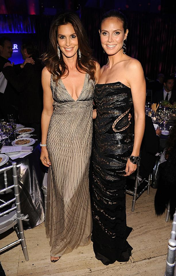 Supermodels Cindy Crawford and Heidi Klum glammed it up at the amfAR <span>2012 New York Gala in support of AIDS research on Wednesday night at Cipriani Wall Street. This was Klum's first red carpet appearance since announcing her split from Seal and she looked better than ever in a strapless Roberto Cavalli creation. Crawford didn't look to bad either in her plunging gown! </span>(2/8/2012)