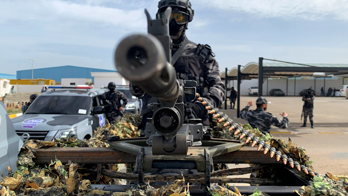 A member of security forces stands behind a weapon, in Tripoli, Libya - 1 February 2021