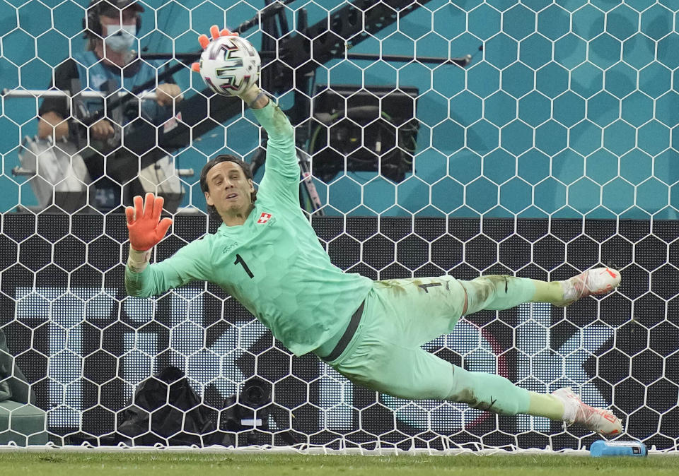 Switzerland's goalkeeper Yann Sommer saves the penalty shot by France's Kylian Mbappe during the Euro 2020 soccer championship round of 16 match between France and Switzerland at the National Arena stadium in Bucharest, Romania, Tuesday, June 29, 2021. (AP Photo/Vadim Ghirda, Pool)