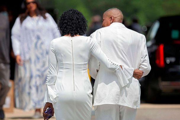 PHOTO: Zsa-Zsa, left, and LaTonya Floyd, sisters of George Floyd, walk to the private viewing and memorial service together outside the Cape Fear Conference B Church in Raeford, N.C., on June 6, 2020, during a memorial for George Floyd. (Ryan M. Kelly/AFP via Getty Images)
