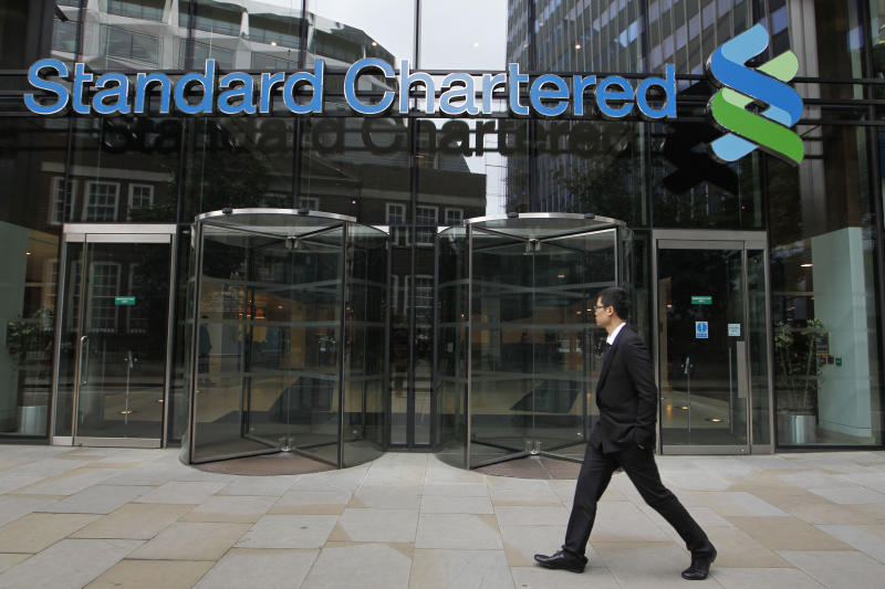 "A man walks by the headquarter of Standard Chartered bank in the City of London, Tuesday, Aug. 7, 2012. Shares in Standard Chartered PLC dropped sharply on Tuesday as investors reacted to U.S. charges that the bank was involved in laundering money for Iran. The charges against Standard Chartered were a shock for a bank which proudly described itself recently as ""boring."" (AP Photo/Sang Tan)"