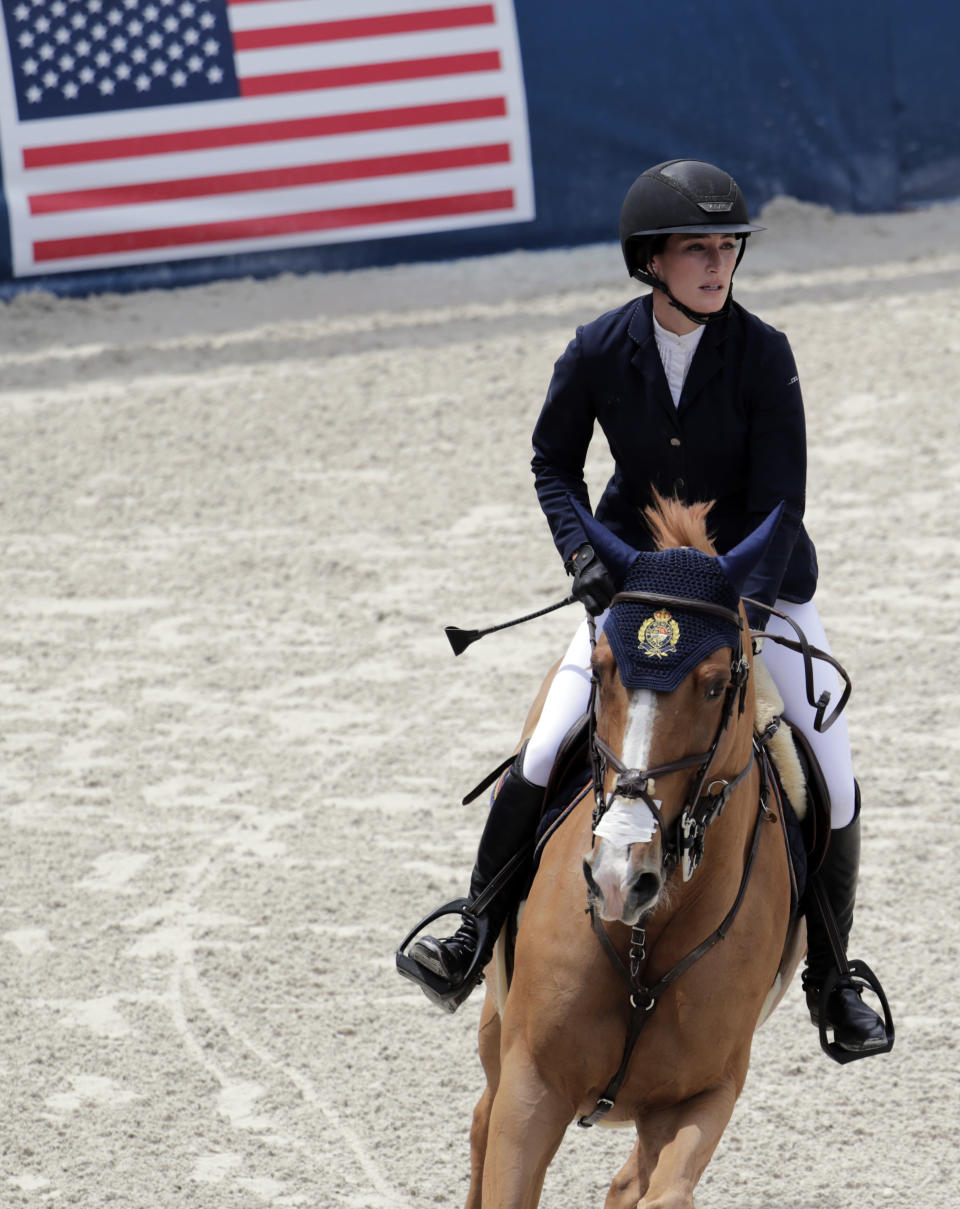 FILE - Jessica Springsteen competes during the Global Champions Tour equestrian event in Miami Beach, Fla., in this April 20, 2019, file photo. The daughter of rock icon Bruce Springsteen and singer-songwriter Patti Scialfa has been selected as one of four riders on the U.S. jumping team that will compete at the Tokyo Olympics. Twenty-nine-year-old Jessica Springsteen is making her Olympic debut.(AP Photo/Lynne Sladky, File)