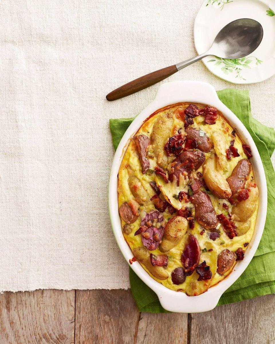 "<p>This hearty dish is delicious as is, but the recipe includes healthier swaps to lighten the calories—and your taste buds won't know the difference. </p><p><strong><a href=""https://www.countryliving.com/food-drinks/recipes/a4555/potato-manchego-casserole-maple-bacon-recipe-clv0314/"" rel=""nofollow noopener"" target=""_blank"" data-ylk=""slk:Get the recipe"" class=""link rapid-noclick-resp"">Get the recipe</a>.</strong></p><p><strong><a class=""link rapid-noclick-resp"" href=""https://www.amazon.com/Bakeware-Krokori-Rectangular-Aquamarine-Rectangula/dp/B074Z5X8MT/?tag=syn-yahoo-20&ascsubtag=%5Bartid%7C10050.g.3726%5Bsrc%7Cyahoo-us"" rel=""nofollow noopener"" target=""_blank"" data-ylk=""slk:SHOP BAKING DISHES"">SHOP BAKING DISHES</a><br></strong></p>"