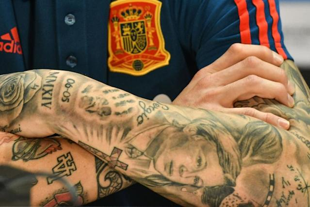 Arms and the man: The tattooed arms of Spain defender Sergio Ramos are pictured during a press conference on the eve of their international friendly against Germany at Duesseldorf on Friday (AFP Photo/Patrik STOLLARZ)