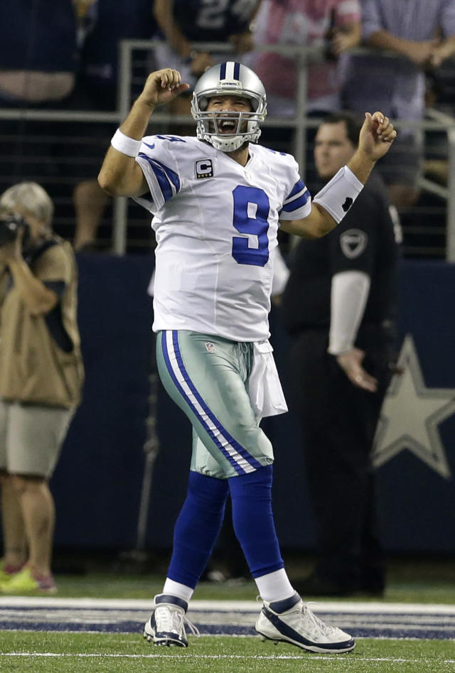Dallas Cowboys quarterback Tony Romo (9) celebrates after running back Joseph Randle (21) scored against the Washington Redskins on a running play in the second half of an NFL football game, Sunday, Oct. 13, 2013, in Arlington, Texas. (AP Photo/LM Otero)