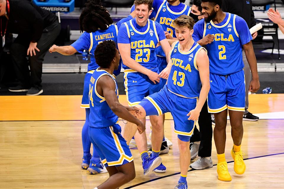 UCLA players celebrate after beating Brigham Young during the first round of the 2021 NCAA Tournament at Hinkle Fieldhouse.