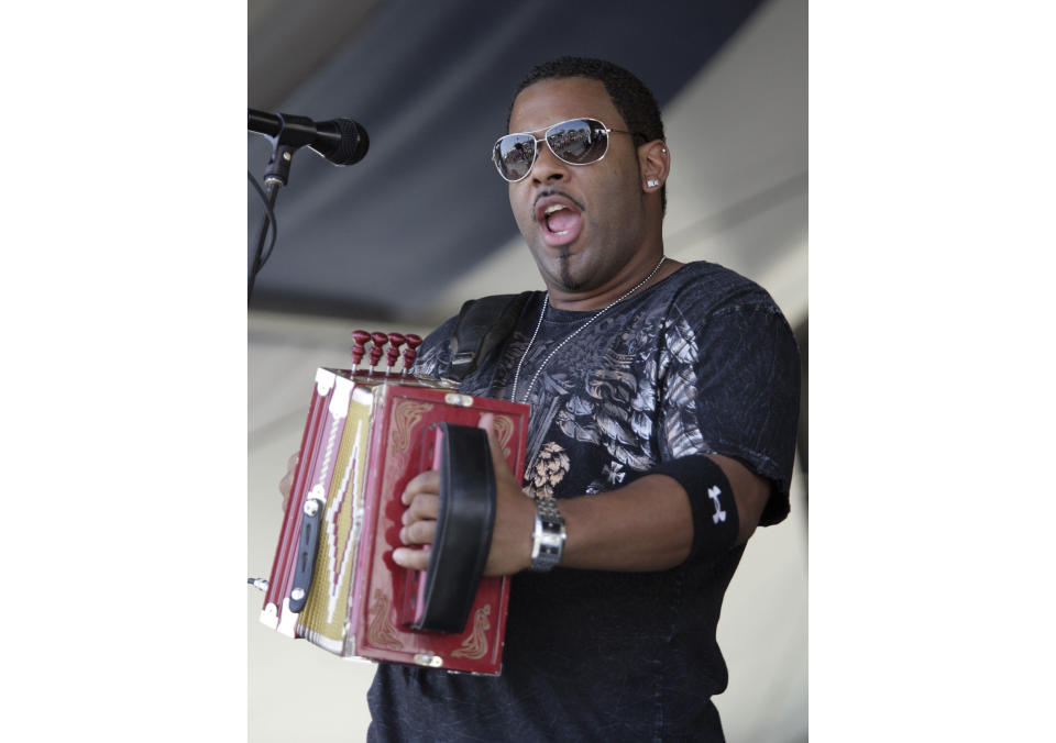 FILE - In this Sunday, May 4, 2008, file photo, Chris Ardoin, of Chris Ardoin & NuStep, performs during the 2008 New Orleans Jazz & Heritage Festival at the New Orleans Fairgrounds Racetrack in New Orleans. Ardoin was performing as the headliner at Zydeco Bike Fest, Friday, July 30, 2021, when he was shot, his wife, Kerri, posted on his official Facebook page. (AP Photo/Dave Martin, File)