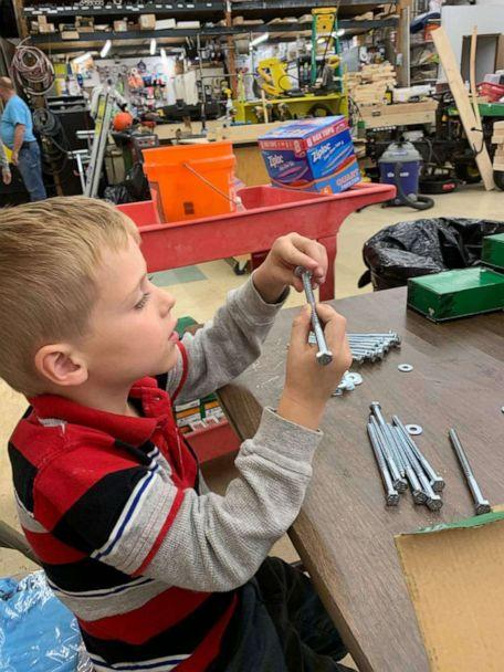 PHOTO: Tyler Sliz, 5, makes bags of bolts, which are then used to assemble beds for children in need. (Courtesy Jackie Sliz)