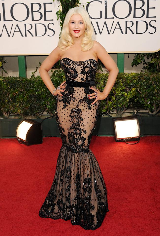 Christina Aguilera wore a glamorous gown that created a sheer illusion at the 2011 Golden Globes red carpet.