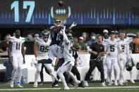 New York Jets cornerback Isaiah Dunn, right, breaks up a pass to Tennessee Titans wide receiver Josh Reynolds, left, during the second half of an NFL football game, Sunday, Oct. 3, 2021, in East Rutherford, N.J. (AP Photo/Bill Kostroun)