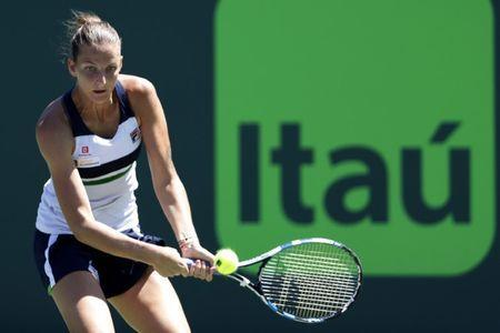 Mar 28, 2017; Miami, FL, USA; Karoilina Pliskova of the Czech Republic hits a backhand against Mirjana Lucic-Baroni of Croatia (not pictured) on day eight of the 2017 Miami Open at Crandon Park Tennis Center. Mandatory Credit: Geoff Burke-USA TODAY Sports