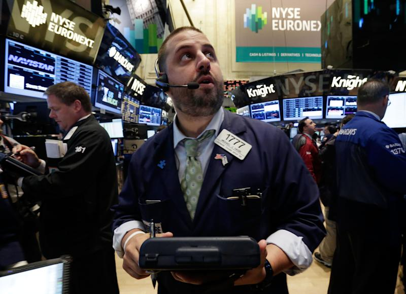 Trader Michael Hagis works on the floor of the New York Stock Exchange Tuesday, June 11, 2013. Stocks are falling in early trading on Wall Street, following global markets lower after the Bank of Japan declined to take further action to shore up that country's financial system. (AP Photo/Richard Drew)