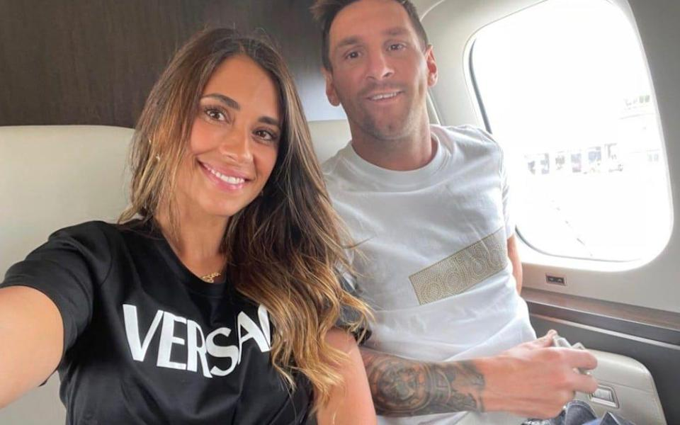 Lionel Messi and his wife, Antonela, on their flight to Paris