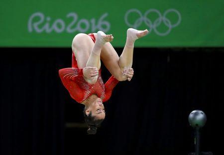 2016 Rio Olympics - Artistic Gymnastics - Final - Women's Individual All-Around Final - Rio Olympic Arena - Rio de Janeiro, Brazil - 11/08/2016. Alexandra Raisman (USA) of the U.S. dismounts from the balance beam. REUTERS/Mike Blake