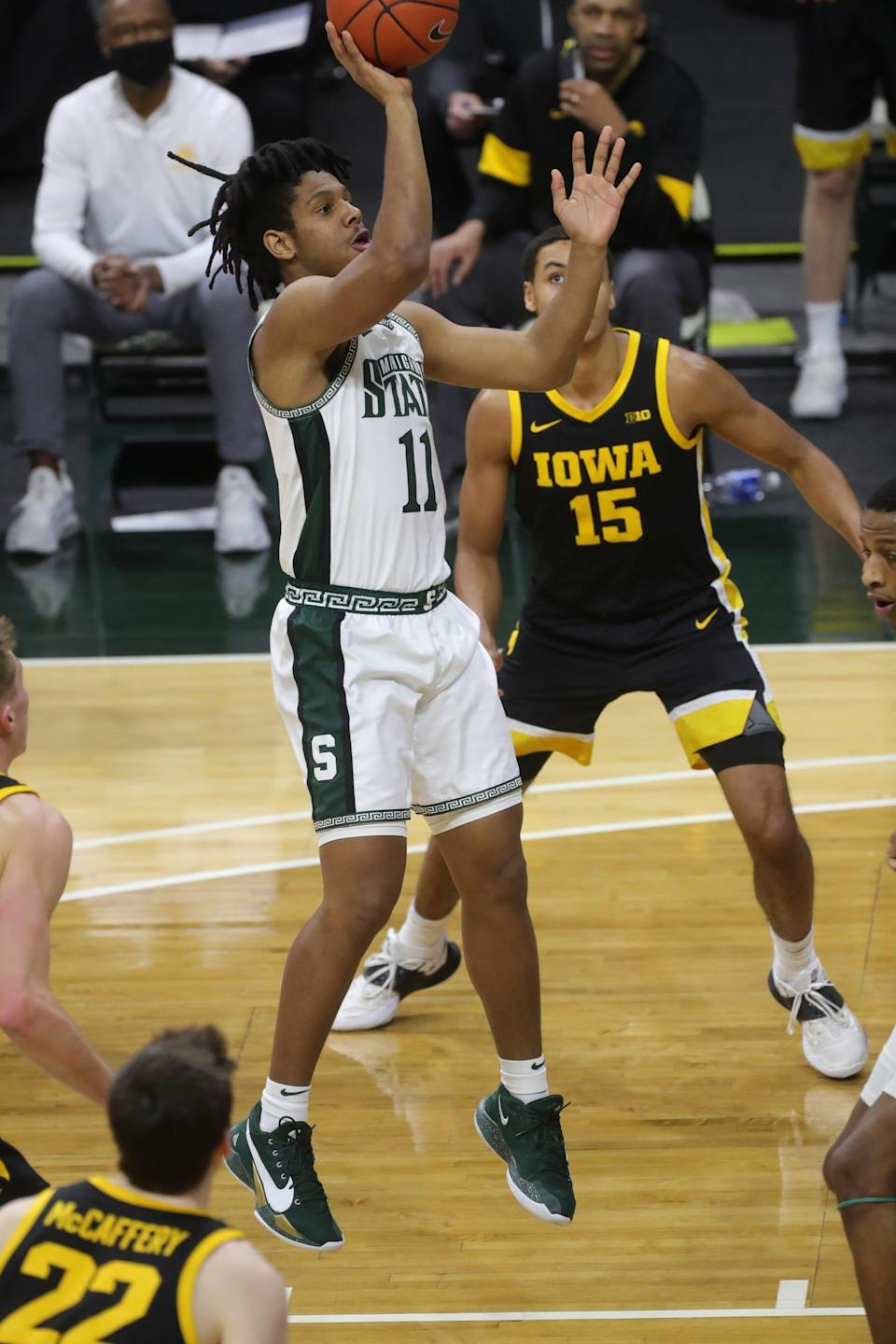 Michigan State Spartans guard A.J. Hoggard (11) shoots against the Iowa Hawkeyes during first half action at Breslin Center Saturday, Feb. 13, 2021.