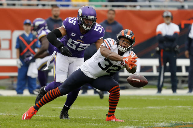 FILE - In this Sept. 29, 2019, file photo, Chicago Bears running back David Montgomery (32) is unable to catch a pass as Minnesota Vikings outside linebacker Anthony Barr defends during the half of an NFL football game, in Chicago. Whether it's Michael Trubisky or Chase Daniel behind center, the Bears have to figure out a way to get their ground game going. (AP Photo/Jeff Roberson, File)