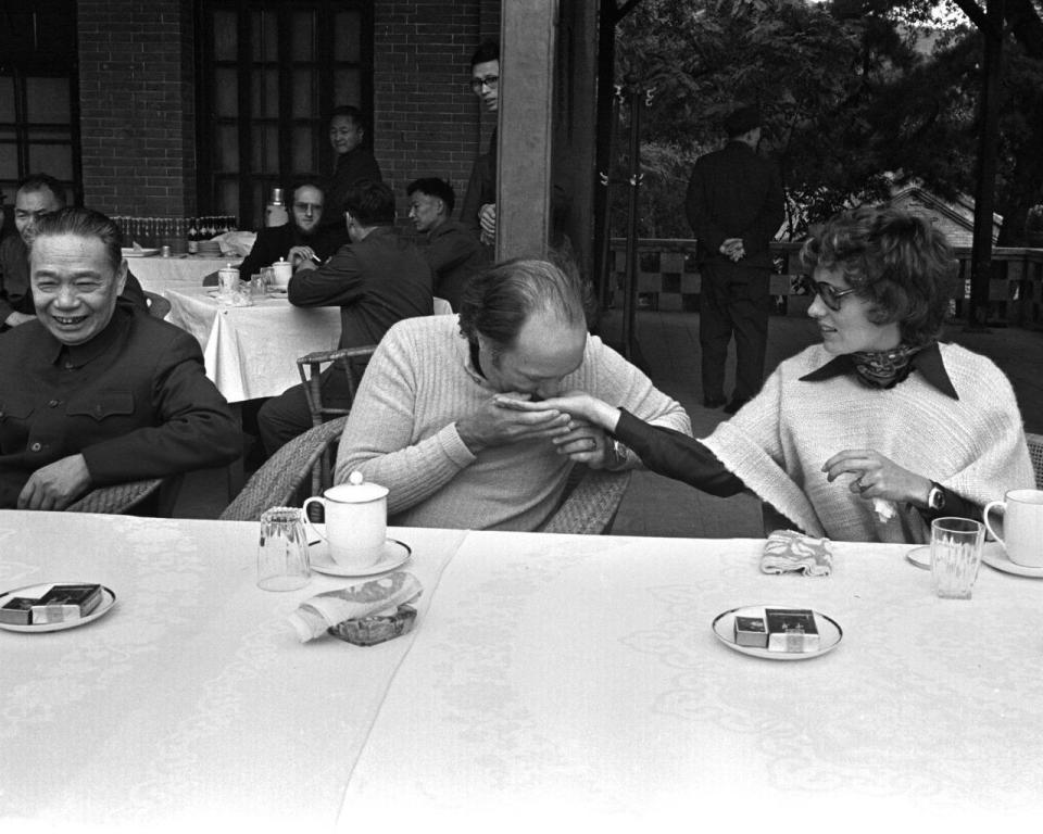 Former prime minister Pierre Trudeau sniffs the fragrance in the hand of his wife Margaret while visiting the Fragrant Hills Park and Summer Palace at the foot of the Western Mountains in the Haidian District, in the northwestern part of Beijing, China, on Oct. 12, 1973. THE CANADIAN PRESS/PETER BREGG