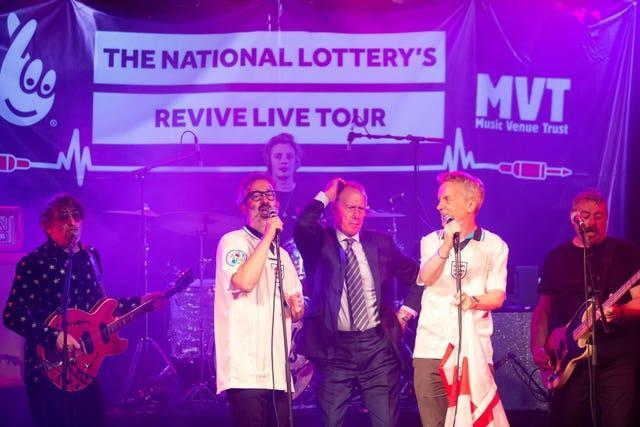 David Baddiel, Frank Skinner and Lighting Seeds with Sir Geoff Hurst performing their song Three Lions (David Parry/PA)