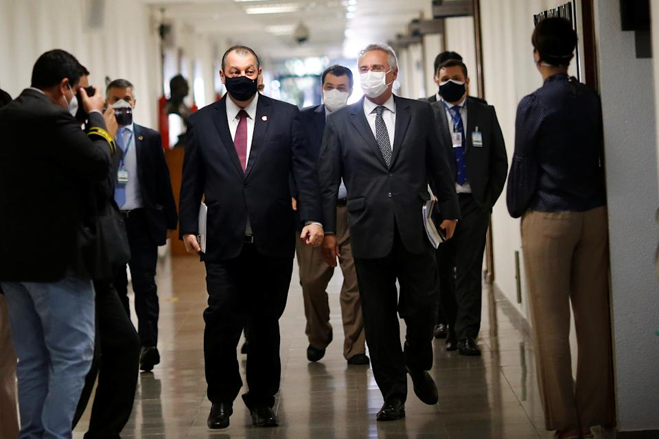 Brazilian Senator Omar Aziz and Renan Calheiros walk before a meeting of the Parliamentary Inquiry Committee (CPI) to investigate government actions and management during the coronavirus disease (COVID-19) pandemic, at the Federal Senate in Brasilia, Brazil May 4, 2021. REUTERS/Adriano Machado