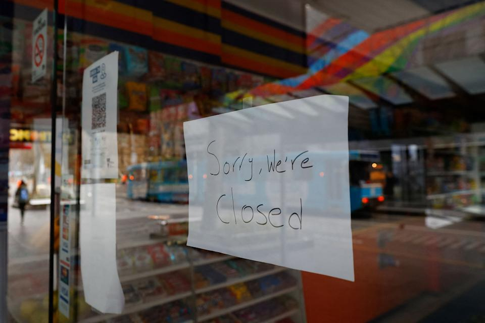 Closed shop signs are displayed in downtown Melbourne on August 6, 2021, amid a sixth lockdown for the city in efforts to bring the Delta outbreak to heel. (Photo by Con Chronis / AFP) (Photo by CON CHRONIS/AFP via Getty Images)