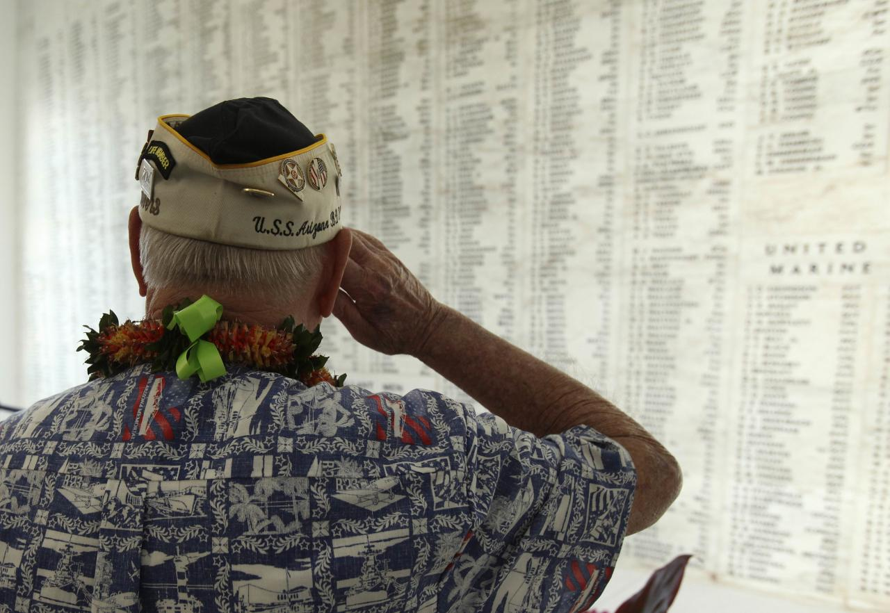 "USS Arizona survivor Louis Conter salutes after placing a wreath at the ""Remembrance Wall"" on board the USS Arizona Memorial during the 72nd anniversary of the attack on Pearl Harbor at the WW II Valor in the Pacific National Monument in Honolulu, Hawaii on December 7, 2013. REUTERS/Hugh Gentry (UNITED STATES - Tags: ANNIVERSARY POLITICS)"