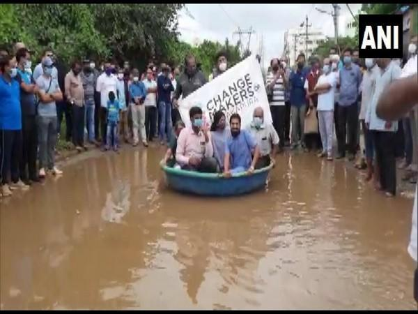Citizens offer boat rides for Rs 20 in Bengaluru's Anjanapura roads. (Photo/ANI)