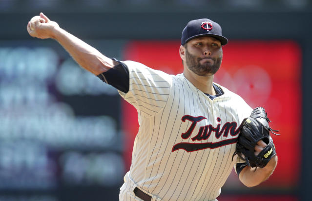 Minnesota Twins pitcher Lance Lynn throws against the Kansas City Royals in the first inning of a baseball game Wednesday, July 11, 2018, in Minneapolis. (AP Photo/Jim Mone)
