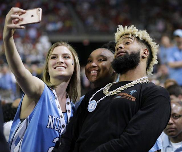 Odell Beckham poses with a fan at the Final Four in April. (AP)