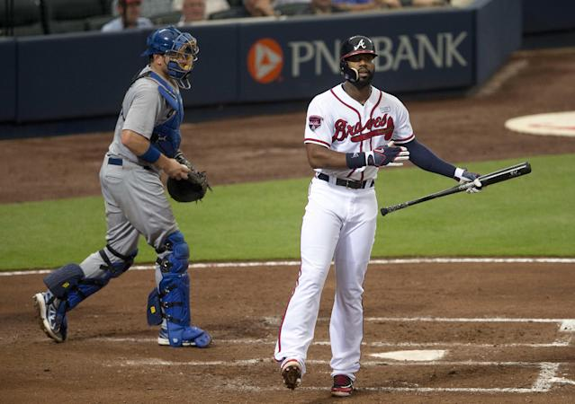 Atlanta Braves' Jason Heyward reacts after striking out to end the fourth inning as Los Angeles Dodgers catcher A.J. Ellis (17) looks n of a baseball game Monday, Aug. 11, 2014 in Atlanta. (AP Photo/John Bazemore)